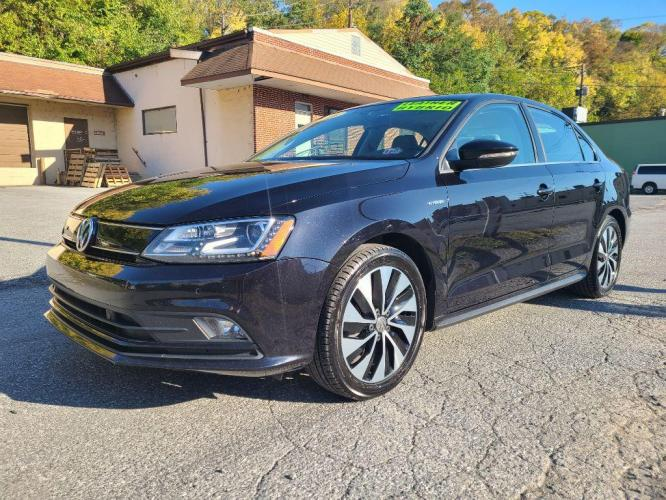 2016 BLACK VOLKSWAGEN JETTA HYBRID (3VW637AJ4GM) with an 1.4L engine, Automatic transmission, located at 7981 Paxton Street, Harrisburg, PA, 17111, (717) 561-2926, 40.261490, -76.749229 - Photo #0